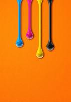 cmyk ink drops on orange paper background