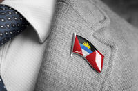 Metal badge with the flag of Antigua and Barbuda on a suit lapel