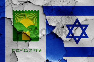 flags of Bnei Brak and Israel painted on cracked wall