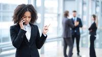Black business woman talking on phone