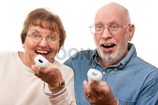 Happy Senior Couple Play Video Game with Remotes