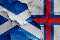 flags of Scotland and Faroe Islands painted on cracked wall