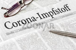 A newspaper with the headline Coronavirus Vaccine in german - Corona-Impfstoff