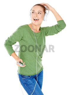 Blissful woman dancing and listening to music