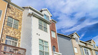 Pano Townhouses on a sunny day setting with balconies overlooking scenic skyscape