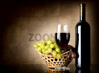 Grapes and a bottle with wine