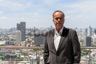Portrait of Indian businessman in city rooftop