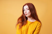 young woman puckering her lips for a kiss or duckface facial expression