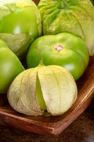 Tomatillos, green tomatoes, Mexican food ingredient on a dark rustic background
