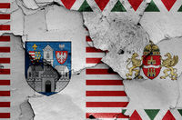 flags of District III. (Obuda-Bekssmegyer) and Budapest painted on cracked wall