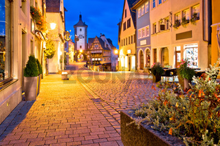 Cobbled street of historic town of Rothenburg ob der Tauber evening view