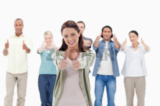 Close-up of people with their thumbs-up