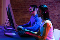 Caucasian man and a mixed race woman working late in a customer support office