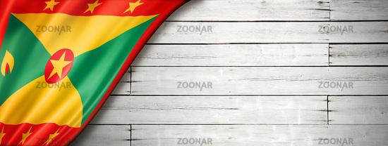 Grenada flag on old white wall banner