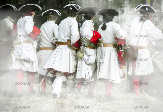 Soldiers with musket and jacket during the re-enactment of the War of Succession. September 4, 2010 in Brihuega, Spain
