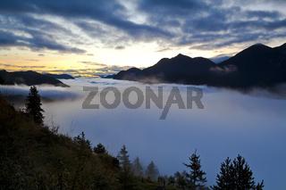 early misty sunrise in Alps