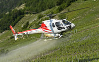 Air-Glaciers helicopter spraying crop protection products on vineyards, Leytron, Valais, Switzerland
