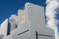 Modern coal power plant with blue sky as background