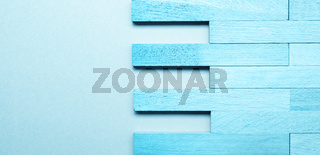 Solid wood parquet in blue as wood texture on blue background with space for text