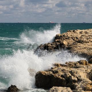 Splash of waves about coastal stones