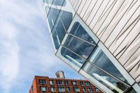 Futuristic office building with metal and glass facade in New York
