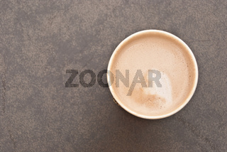 a cup of hot coffee in paper cup