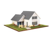 Miniature house with garden furniture