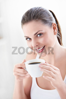 An attractive woman with coffee