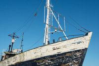 Old abandoned fishing boat ashore