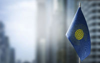 A small flag of Commonwealth on the background of a blurred background