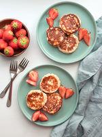 Cottage cheese pancakes, syrniki, ricotta fritters