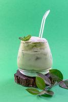Glass of iced green matcha latte.