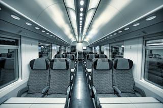 Modern train coach interior view.