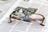 reading glasses lying on the paper