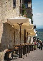 Restaurant at historic medieval city of San Gimignano in the province of Siena, Tuscany, Italy.