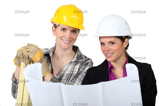 craftswoman and businesswoman looking at a blueprint