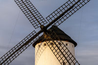 A close up view of a historic whitewashed windmill in La Mancha