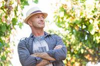 Handsome senior man in straw hat