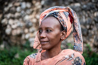 Black African senior beautiful woman with scarf outdoors portrait