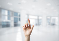 Choosing gesture of person in elegant modern interior in sunshine light