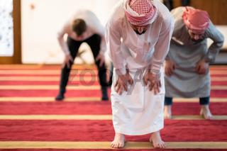 group of muslim people praying namaz in mosque.