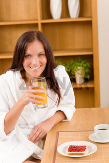 Breakfast home happy woman with orange juice