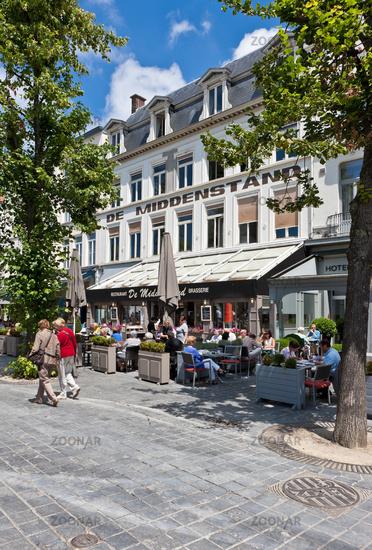 Tourists in street cafés