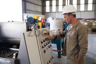 Attentive technician operating a machine