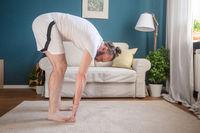 Man practice yoga at home