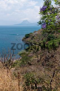 Top view of lake Atitlan and volcano crater at a sunny place in nature, San Pedro la Laguna, Guatemala