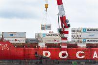 Crane unloading Russian container ship Sevmorput Rosatomflot - nuclear-powered icebreaker lighter aboard ship carrier