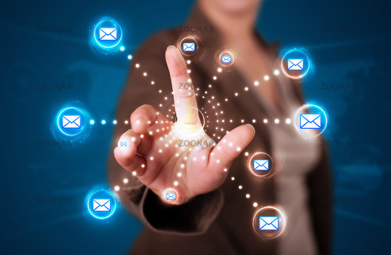 Woman pressing virtual messaging type of icons
