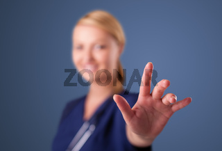 Young female doctor gesturing with copy space