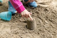 A child playing with the sand.